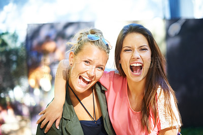 Buy stock photo Two young female friends having fun at an outdoor event