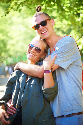 Buy stock photo Two young people smiling happily while standing outside