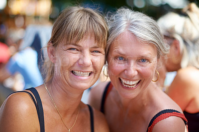 Buy stock photo Portrait of two mature women enjoying themselves at an outdoor festival