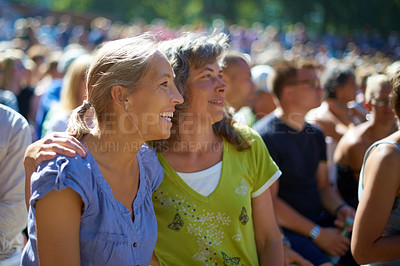 Buy stock photo Shot of two women enjoying themselves at an outdoor festival