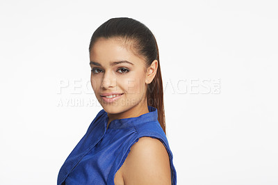 Buy stock photo Studio shot of a young brunette smiling at the camera
