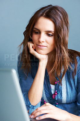 Buy stock photo Cute young woman using laptop