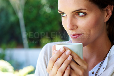 Buy stock photo Cute young woman looking away with a coffee cup