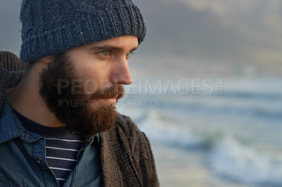 Buy stock photo Cropped shot of a bearded man standing on the beach