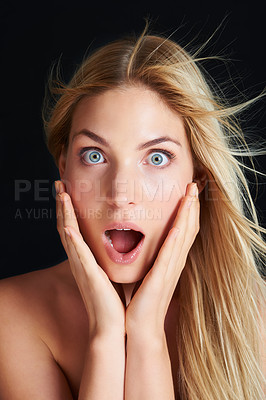 Buy stock photo Portrait of a beautiful young woman looking shocked