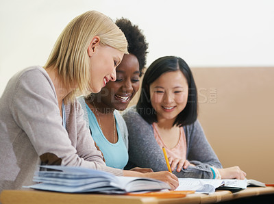 Buy stock photo Shot of female university students sitting in an exam room