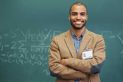 Buy stock photo Portrait of a handsome young teacher standing with his arms folded