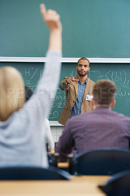 Buy stock photo Shot of a young male teacher giving a lesson to his students on the lecture hall