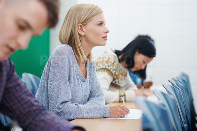 Buy stock photo Shot of university students in a classroom
