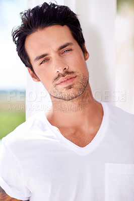 Buy stock photo Shot of ruggedly handsome young man