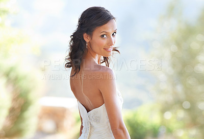Buy stock photo Portrait of an attractive young woman in a wedding dress looking back