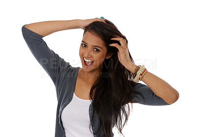 Buy stock photo A young ethnic woman smiling as she runs her fingers through her hair