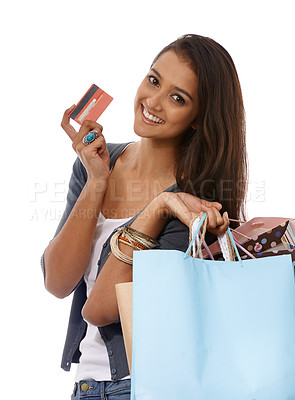 Buy stock photo A young ethnic woman holding a credit card and lots of shopping bags