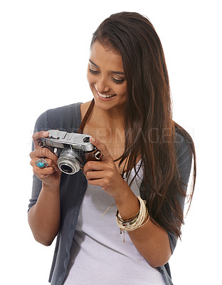 Buy stock photo Cropped view of a young woman holding a retro camera against a white background
