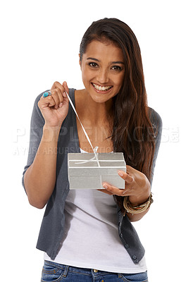 Buy stock photo Cropped studio shot of a cute young woman opening a gift in excitement