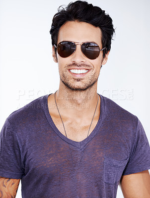Buy stock photo Cropped view of a trendy young guy smiling while wearing shades