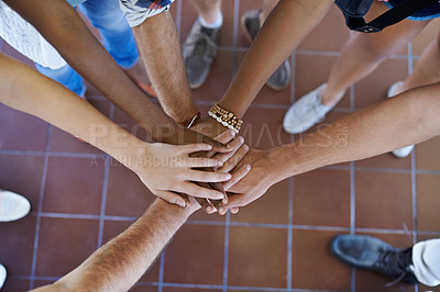 Buy stock photo Cropped view of a multiethnic group putting their hands together in unity