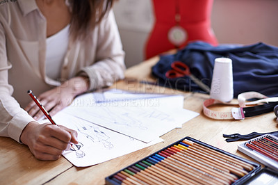 Buy stock photo A fashion designer creating sketches in her office