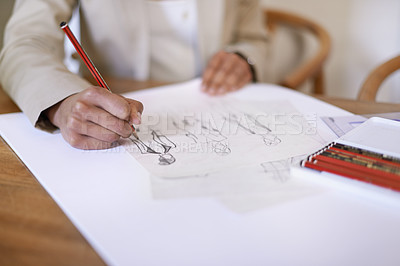 Buy stock photo Cropped image of a fashion designer making drawings