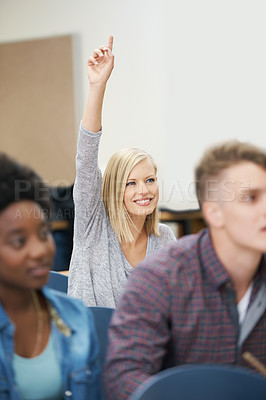 Buy stock photo Shot of an enthusiastic female student putting her hand up in a Lecture