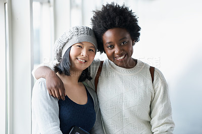 Buy stock photo Portrait of two University students hugging and smiling