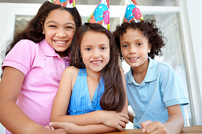 Buy stock photo Portrait of three young children at a birthday party