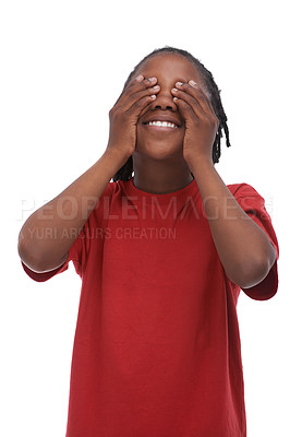 Buy stock photo A young African-American boy covering his eyes while standing against a white background