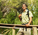 Young guy trekking in the bush