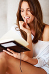 Sexy young woman reading a diary