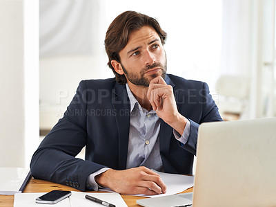 Buy stock photo A handsome businessman reflecting over his thoughts while at his desk
