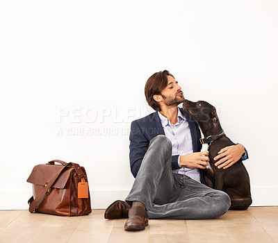 Buy stock photo A handsome businessman sitting alongside his loyal dog