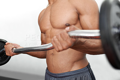 Buy stock photo A man doing weight training in a gym