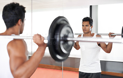 Buy stock photo A fitness shot of an athletic young man