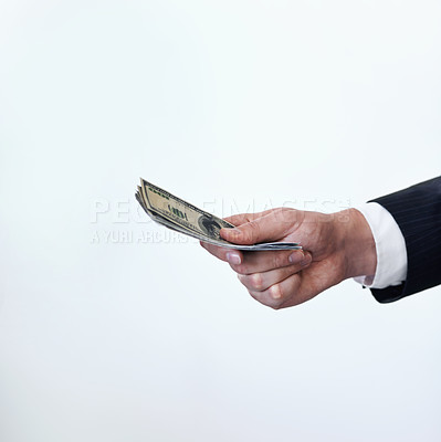 Buy stock photo Conceptual shot of a businessman stretching out his hand holding money