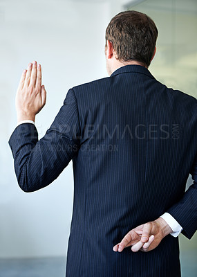 Buy stock photo Cropped shot of a businessman crossing his fingers behind his back
