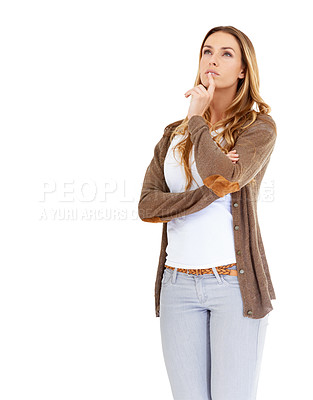Buy stock photo Studio shot of a beautiful young woman posing against a white background looking thoughtful