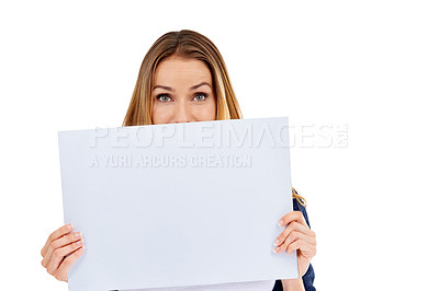 Buy stock photo A young woman looking over the side of a blank placard