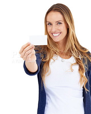 Buy stock photo A young woman holding a blank business card and smiling
