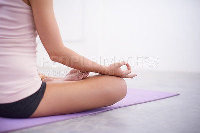 Buy stock photo A young woman meditating in a yoga studio