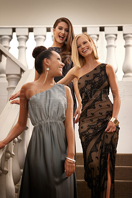 Buy stock photo Shot of beautiful women standing on an ornate staircase