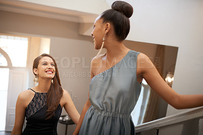 Buy stock photo Shot of two beautiful women standing on an ornate staircase
