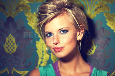 Buy stock photo Shot of a beautiful young woman in a club-like scene