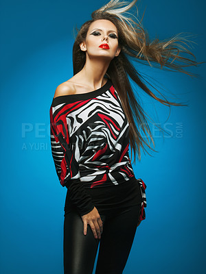 Buy stock photo Portrait of a woman in sexy leather trousers and a retro patterned jersey