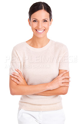 Buy stock photo A casually dressed young woman standing with her arms folded