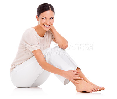 Buy stock photo Studio shot of a casually dressed young woman sitting on the floor