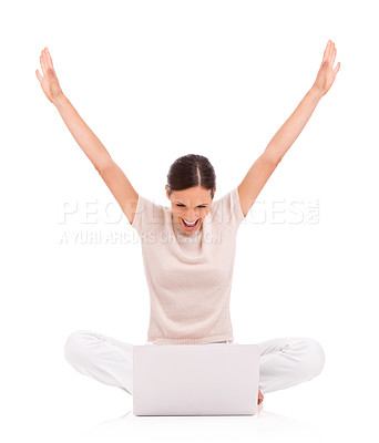 Buy stock photo A young woman sitting with her laptop and raising her arms in victory