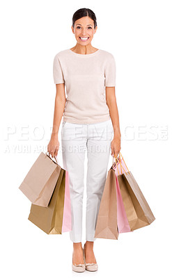 Buy stock photo An attractive young woman holding carrying many shopping bags