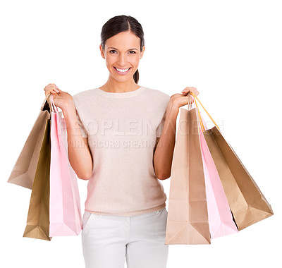 Buy stock photo Studio portrait of an attractive woman holding up shopping bags