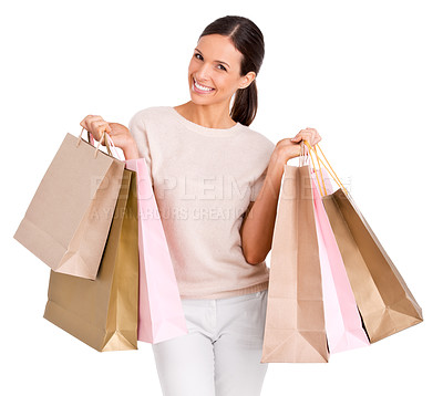 Buy stock photo Studio portrait of an attractive young woman holding up shopping bags
