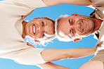 Upward view of an old couple with blue sky as the background